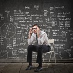 Scientist thinks about formulas and hypothesis - reducing uncertainty